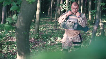 munitions : Military wears body armor in the forest