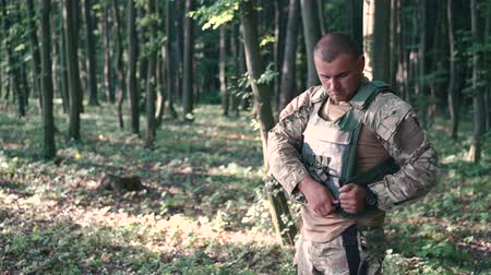 bravery : Warrior wears body armor in the forest