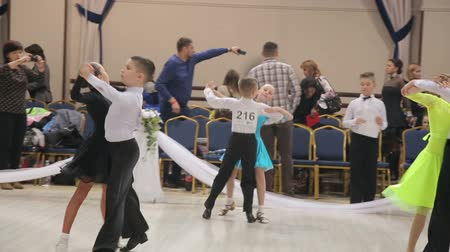 viennese : UKRAINE, TERNOPIL, MARCH 12, 2016: Children couples - dancing waltz on the contest Grande Cup Stock Footage