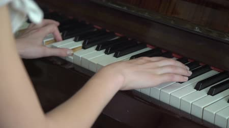 sonata : Young hands playing on the piano keyboard