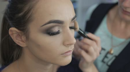 применения : Beautiful girl getting professional makeup