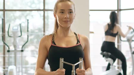 bicep : Woman workout with power simulator in the modern gym