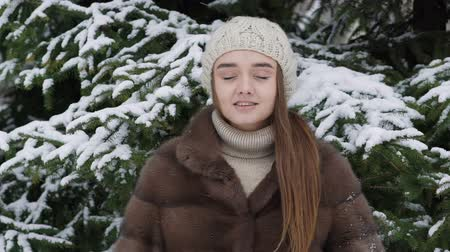 глыба : A lump of snow falling on the girl standing near tree. Slow motion Стоковые видеозаписи