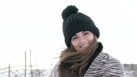 rüzgârla oluşan kar yığını : Attractive girl smiling and looking to camera at windy cold winter day