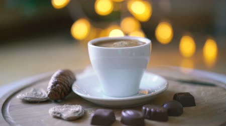 hot beverage : Rotating wooden background with coffee, candies and biscuit in 4K