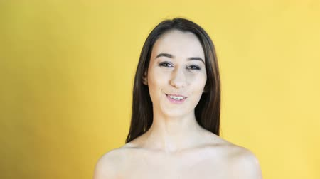 temperament : Portrait of smiling girl on yellow background in 4K Stock Footage