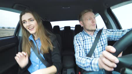 slowing : Funny couple singing, dancing, taking selfie, suddenly slowing to avoid accident