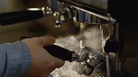 bung : Male hands fasten coffee maker for preparing. Slowly