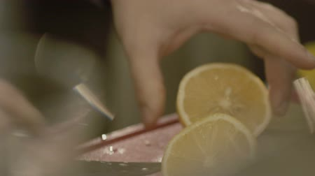 Hands slicing the lemon. Slowly Wideo
