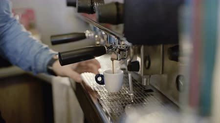 bung : Baristas hands makes coffee in coffee maker. 4K Stock Footage
