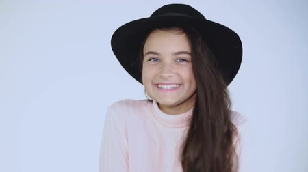 camera move : Pretty young lady in hat cheerfully poses at camera. Stock Footage