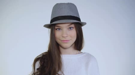 koketa : Pretty young and playful girl with hat on head poses at camera