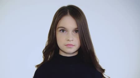seriously : The serious look at camera of the prettiest young brunette Stock Footage