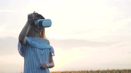 mobile game : Girl Cheering in Virtual Reality Glasses Outdoors Stock Footage