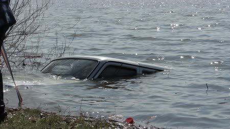 pulling off : Car sank in the lake 2 Stock Footage