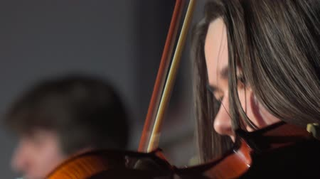 jazz festival : SAMARA, RUSSIA - APRIL 02, 2018: Face of a young woman playing the violin close-up Stock Footage