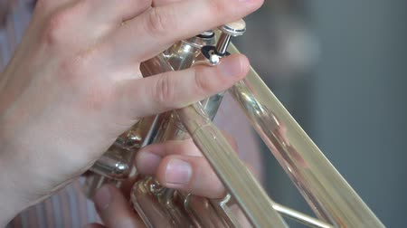 brazen : Hands trumpeter playing on the trumpet
