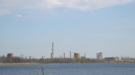 malom : Old Abandoned chemical factory with chimneys on the banks of the river