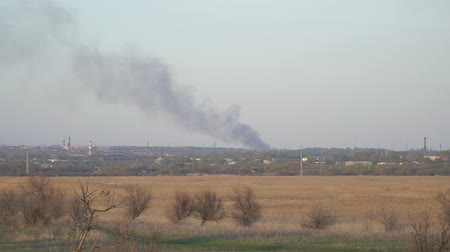 fat burning : Smoke from a fire in the distance