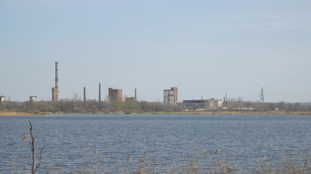 рецессия : Old Abandoned chemical factory with chimneys on the banks of the river