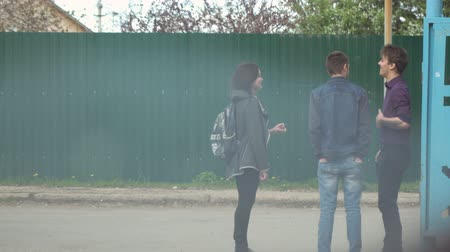 teen age : CHAPAEVSK, SAMARA REGION, RUSSIA - MAY 28, 2018: Teens boys and girls Smoking on the street
