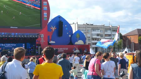 fan fest : SAMARA, RUSSIA - JUNE 21, 2018: Football fan waving the Russian flag in the fan zone of the 2018 FIFA world Cup in Samara Stock Footage