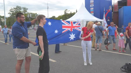 fan fest : SAMARA, RUSSIA - JUNE 21, 2018: Football fans with the flag of Australia in the fan zone of the world Cup 2018 in Samara on Kuibyshev square