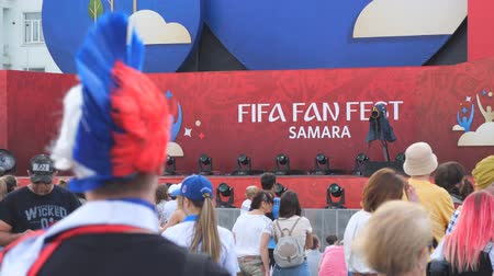 fan zone : SAMARA, RUSSIA - JUNE 21, 2018: Russian football fan of the 2018 FIFA world Cup in Samara. Selective focus Stock Footage