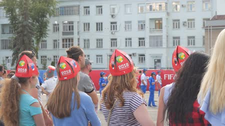 tournament : SAMARA, RUSSIA - JUNE 21, 2018: Russian girls are fans of the 2018 FIFA world Cup in Samara on Kuibyshev square