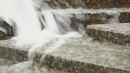 torrential : A stream of water from the fountain on the granite Stock Footage