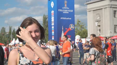 fan fest : SAMARA, RUSSIA - JUNE 21, 2018: The girl in the fan zone of the FIFA world Cup 2018 in Samara on the area of Kuibyshev