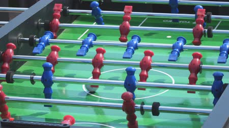 skorlama : SAMARA, RUSSIA - JUNE 19, 2018: People play kicker table football soccer. Table soccer Stok Video