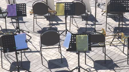 opus : Empty chairs and notes on the music stand. Empty seats in the orchestra