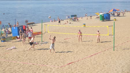 volleyball : SAMARA, RUSSIA - JUNE 19, 2018: A group of people, men and women playing Beach volleyball