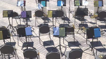 opus : Russia, Samara, May 27, 2018: Empty chairs and notes on the music stand. Empty seats in the orchestra