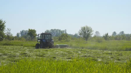 hay fields : Tractor mowing grass in the meadow