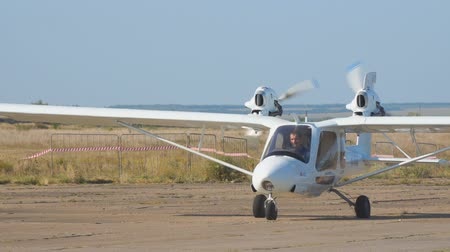 lightweight : Samara, Russia - September 17, 2018: Light private twin-engined aircraft plane on the runway Stock Footage