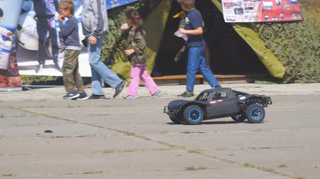 sürücü : Samara, Russia - September 11, 2018: A black radio-controlled model of a car drives fast in the park