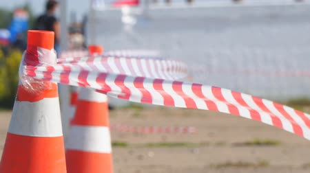 dividing : Fencing tape and road cone. Selective focus Stock Footage