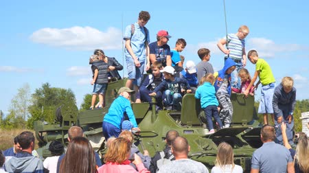 fire arms : Samara, Russia - September 24, 2018: Exhibition of military equipment in the Park of Samara. Children inspect and play on military vehicle