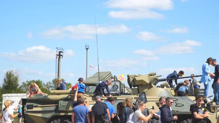 gunshot : Samara, Russia - September 24, 2018: Exhibition of military equipment in the Park of Samara. Children inspect and play on military vehicle