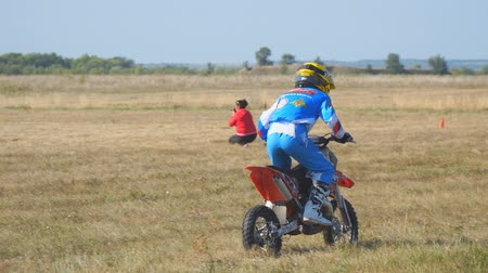 rider : Samara, Russia - September 11, 2018: Training motorcycle rider of the Samara motor club. Enduro racer rides a motocross bike
