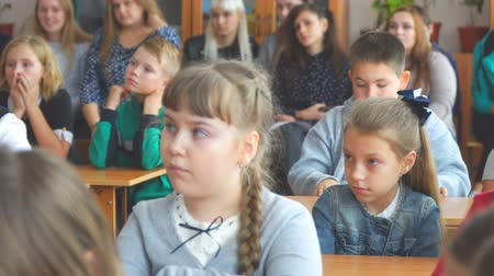 notas : CHAPAEVSK, SAMARA REGION, RUSSIA - OCTOBER 24, 2018: School kids in the classroom sitting at their desks and listen to the teacher. Selective focus. Camera zooming Stock Footage