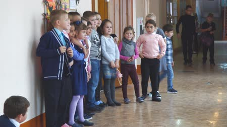 recess : CHAPAEVSK, SAMARA REGION, RUSSIA - OCTOBER 24, 2018: School children at recess in the hallway