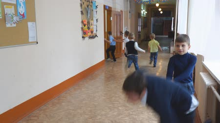 детская площадка : CHAPAEVSK, SAMARA REGION, RUSSIA - OCTOBER 24, 2018: School children at recess in the hallway. Boys playing in the hallway of the school