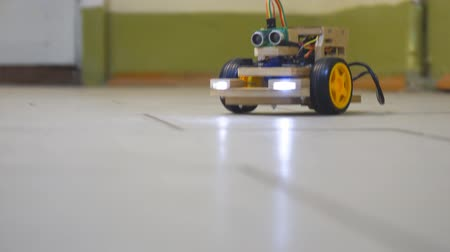 ピックアップ : Homemade model cars rides on the floor. Designs the model of the machine or car. Modeling 動画素材