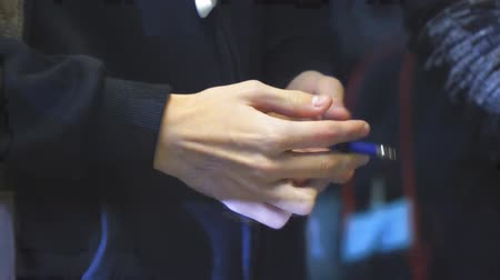 impatience : A man nervously holding and twirling a pen in his hands Stock Footage