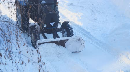 snow plow : Snowplow on the street. A tractor clears snow from the road
