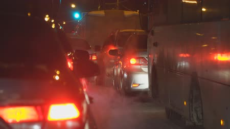 clogged : Samara, Russia - January 09, 2019: Cars in traffic in winter at night Stock Footage