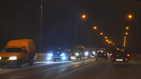 şartlar : Samara, Russia - January 02, 2019: Driving on the night road in winter Stok Video